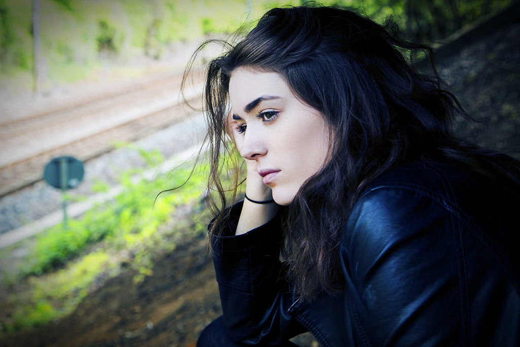 image of girl overlooking a train track