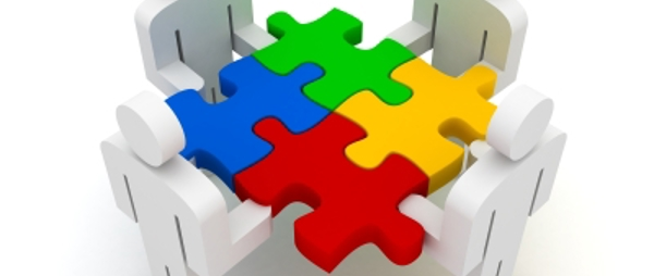 image of characters in the shape of people holding four different jigsaw peices interlinked - jigsaw pieces are in different colours