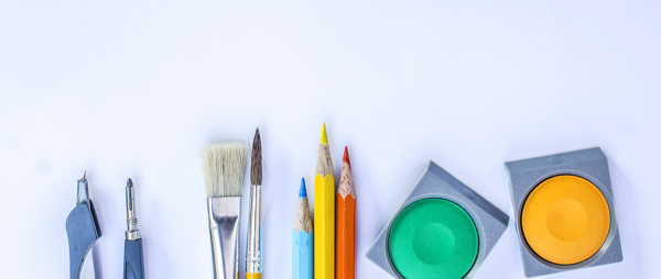 image of pencils, paint brushes and pots of paint