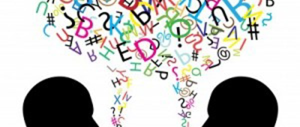 image of silhouette of two people heads facing each other with a creative bubble with various letters forming above