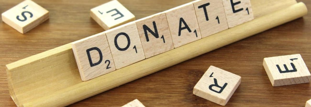 image of scrabble pieces spelling the word donate
