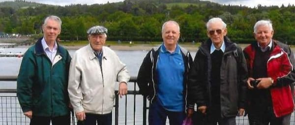 image of male carers standing infront of a waterfront